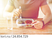Купить «close up of man with fork and water eating food», фото № 24854729, снято 14 мая 2015 г. (c) Syda Productions / Фотобанк Лори