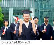 Купить «happy student with diploma celebrating graduation», фото № 24854769, снято 24 сентября 2016 г. (c) Syda Productions / Фотобанк Лори