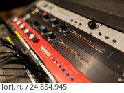 Купить «music mixing console at sound recording studio», фото № 24854945, снято 18 августа 2016 г. (c) Syda Productions / Фотобанк Лори