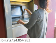 Купить «close up of woman inserting card to atm machine», фото № 24854953, снято 8 сентября 2016 г. (c) Syda Productions / Фотобанк Лори