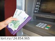 Купить «close up of hand withdrawing money at atm machine», фото № 24854965, снято 8 сентября 2016 г. (c) Syda Productions / Фотобанк Лори