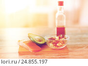 Купить «close up of food and olive oil bottle on table», фото № 24855197, снято 14 мая 2015 г. (c) Syda Productions / Фотобанк Лори