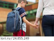Купить «elementary student boy with mother at school yard», фото № 24855249, снято 24 июля 2016 г. (c) Syda Productions / Фотобанк Лори