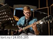 Купить «man playing guitar at studio rehearsal», фото № 24855285, снято 18 августа 2016 г. (c) Syda Productions / Фотобанк Лори
