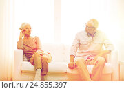 Купить «senior couple sitting on sofa at home», фото № 24855397, снято 4 сентября 2014 г. (c) Syda Productions / Фотобанк Лори