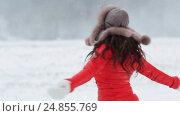 Купить «happy woman having fun outdoors in winter», видеоролик № 24855769, снято 12 января 2017 г. (c) Syda Productions / Фотобанк Лори