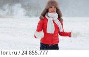 Купить «happy woman having fun outdoors in winter», видеоролик № 24855777, снято 12 января 2017 г. (c) Syda Productions / Фотобанк Лори