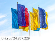 Купить «Colorful flags waving on blue sky background», фото № 24857229, снято 19 августа 2018 г. (c) FotograFF / Фотобанк Лори