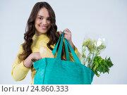 Купить «Beautiful woman carrying grocery bag», фото № 24860333, снято 15 сентября 2016 г. (c) Wavebreak Media / Фотобанк Лори
