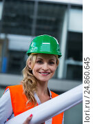 Купить «Portrait of architect woman in hardhat holding blueprints», фото № 24860645, снято 6 июля 2016 г. (c) Wavebreak Media / Фотобанк Лори