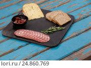 Купить «Brown bread, dutch gouda cheese, rosemary and ham on slate board», фото № 24860769, снято 16 сентября 2016 г. (c) Wavebreak Media / Фотобанк Лори