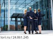 Купить «Businesspeople forming a huddle in office premises», фото № 24861245, снято 6 июля 2016 г. (c) Wavebreak Media / Фотобанк Лори