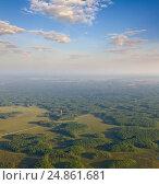 Купить «Telecommunications tower on a forest, top view», фото № 24861681, снято 27 июня 2015 г. (c) Владимир Мельников / Фотобанк Лори