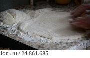 Купить «Woman rolls fancy pastry with rolling pin», видеоролик № 24861685, снято 6 января 2017 г. (c) Володина Ольга / Фотобанк Лори