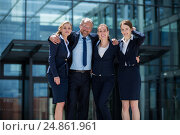 Купить «Happy businesspeople standing in office premises», фото № 24861961, снято 6 июля 2016 г. (c) Wavebreak Media / Фотобанк Лори
