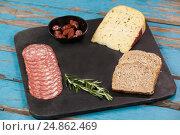 Купить «Brown bread, dutch gouda cheese, rosemary and ham on slate board», фото № 24862469, снято 16 сентября 2016 г. (c) Wavebreak Media / Фотобанк Лори