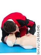 Купить «Paramedic practising resuscitation on dummy», фото № 24864045, снято 25 августа 2016 г. (c) Wavebreak Media / Фотобанк Лори