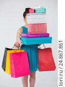 Купить «Woman carrying stack of gift boxes and shopping bags», фото № 24867861, снято 15 сентября 2016 г. (c) Wavebreak Media / Фотобанк Лори