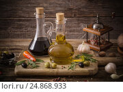 Купить «olive oil flavored with spices and other ingredients», фото № 24868933, снято 24 ноября 2016 г. (c) Майя Крученкова / Фотобанк Лори