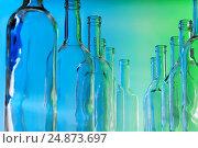 Купить «Bottlenecks of glass bottles standing in line», фото № 24873697, снято 5 января 2016 г. (c) Сергей Новиков / Фотобанк Лори