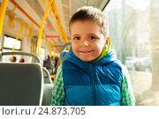 Купить «Happy boy traveling by city public transport», фото № 24873705, снято 13 апреля 2016 г. (c) Сергей Новиков / Фотобанк Лори