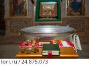 Купить «The Bible and the cross. Preparing for the rite of infant baptism», фото № 24875073, снято 28 мая 2016 г. (c) Анастасия Улитко / Фотобанк Лори