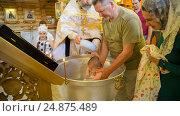Купить «Обряд крещения ребенка в православной церкви», фото № 24875489, снято 28 мая 2016 г. (c) Анастасия Улитко / Фотобанк Лори
