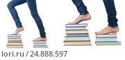 Купить «Student stepping on stack of books», фото № 24888597, снято 22 августа 2012 г. (c) Elnur / Фотобанк Лори