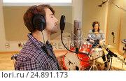 Купить «Music band performing in a studio», видеоролик № 24891173, снято 8 июля 2020 г. (c) Wavebreak Media / Фотобанк Лори