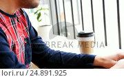 Купить «Man using laptop while having coffee», видеоролик № 24891925, снято 18 июля 2019 г. (c) Wavebreak Media / Фотобанк Лори