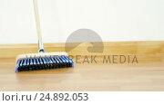 Купить «Broom with wooden handle», видеоролик № 24892053, снято 5 августа 2020 г. (c) Wavebreak Media / Фотобанк Лори