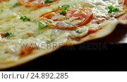 Купить «Baked pizza with cherry tomato toppings», видеоролик № 24892285, снято 6 декабря 2019 г. (c) Wavebreak Media / Фотобанк Лори