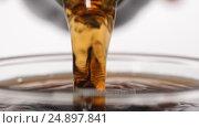 Купить «SLOW MOTION: Human hand pours a brown beverage from a glass bottle», видеоролик № 24897841, снято 18 января 2017 г. (c) Евгений Киблер / Фотобанк Лори