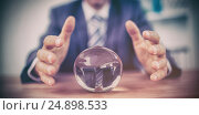 Купить «Businessman forecasting a crystal ball», фото № 24898533, снято 21 июля 2018 г. (c) Wavebreak Media / Фотобанк Лори