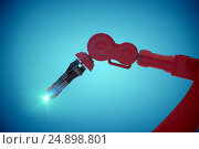 Composite image of close-up of red robot claw 3d. Стоковое фото, агентство Wavebreak Media / Фотобанк Лори