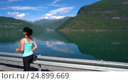 Купить «Woman jogging outdoors», видеоролик № 24899669, снято 17 октября 2016 г. (c) Андрей Армягов / Фотобанк Лори
