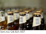 Купить «close up of bottles at liquor store», фото № 24921937, снято 2 ноября 2016 г. (c) Syda Productions / Фотобанк Лори