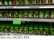 Купить «jars of pickles on grocery or supermarket shelves», фото № 24921953, снято 2 ноября 2016 г. (c) Syda Productions / Фотобанк Лори
