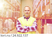 Купить «happy man in reflective safety vest at warehouse», фото № 24922137, снято 9 декабря 2015 г. (c) Syda Productions / Фотобанк Лори