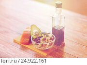 Купить «close up of food and olive oil bottle on table», фото № 24922161, снято 14 мая 2015 г. (c) Syda Productions / Фотобанк Лори