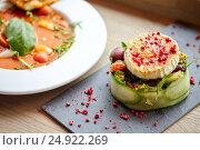 Купить «goat cheese salad and gazpacho soup at restaurant», фото № 24922269, снято 22 сентября 2016 г. (c) Syda Productions / Фотобанк Лори