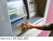 Купить «close up of hand entering pin code at atm machine», фото № 24922281, снято 8 сентября 2016 г. (c) Syda Productions / Фотобанк Лори