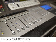 Купить «music mixing console at sound recording studio», фото № 24922309, снято 18 августа 2016 г. (c) Syda Productions / Фотобанк Лори