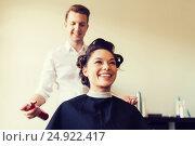Купить «happy woman with stylist making hairdo at salon», фото № 24922417, снято 15 февраля 2015 г. (c) Syda Productions / Фотобанк Лори