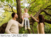 Купить «happy family in summer park having fun», фото № 24922493, снято 2 сентября 2016 г. (c) Syda Productions / Фотобанк Лори