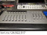 Купить «music mixing console at sound recording studio», фото № 24922517, снято 18 августа 2016 г. (c) Syda Productions / Фотобанк Лори