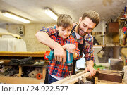 Купить «father and son with drill working at workshop», фото № 24922577, снято 14 мая 2016 г. (c) Syda Productions / Фотобанк Лори