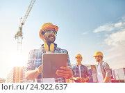Купить «builder in hardhat with tablet pc at construction», фото № 24922637, снято 21 сентября 2014 г. (c) Syda Productions / Фотобанк Лори