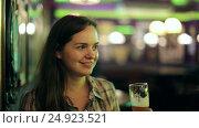 Купить «girl sits in bar», видеоролик № 24923521, снято 3 октября 2016 г. (c) Яков Филимонов / Фотобанк Лори