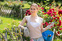 pretty young woman working with bush roses with horticultural tools in garden, фото № 24923937, снято 22 января 2017 г. (c) Яков Филимонов / Фотобанк Лори